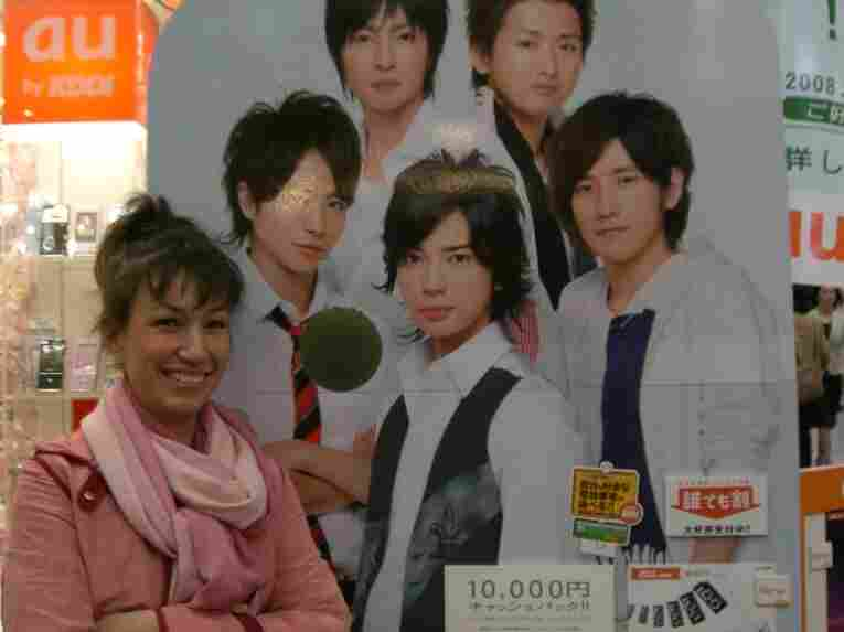 Marie Mutsuki Mockett is the author of Picking Bones from Ash. She is pictured here with a poster of the Japanese boy band, Arashi, in Kyoto, Japan. Band member Jun Matsumoto (center) played Doumyoji in the televised version of Hana Yori Dango.