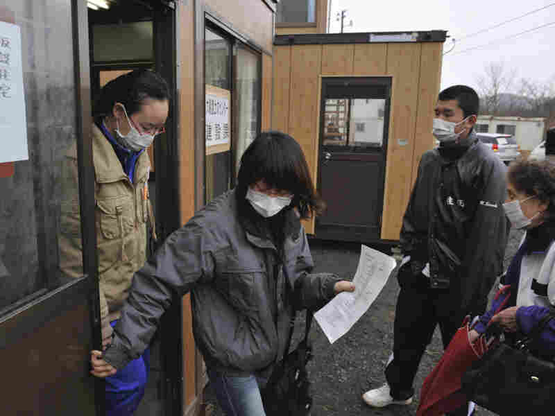 Evacuees who lost their homes in the March 11 earthquake and tsunami visit a makeshift city hall to apply for temporary housing in Rikuzentakata, Japan.