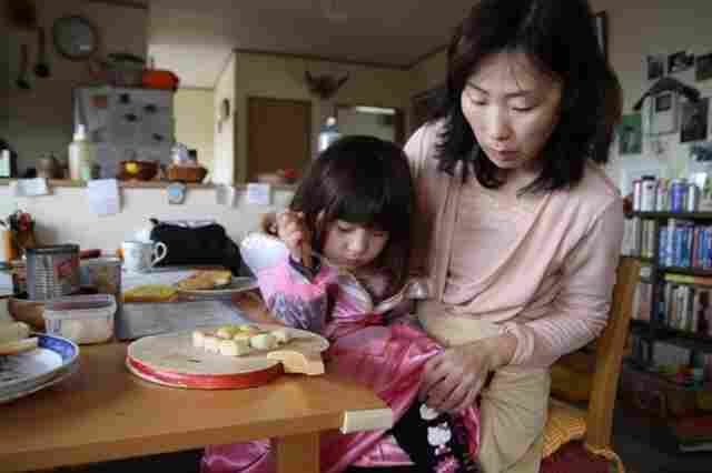 Junko Holland gets her daughter Sophie ready for school in the small town of Aizuwakamatsu. The family is trying to find some normalcy while living uncomfortably close to a quake-damaged nuclear plant.