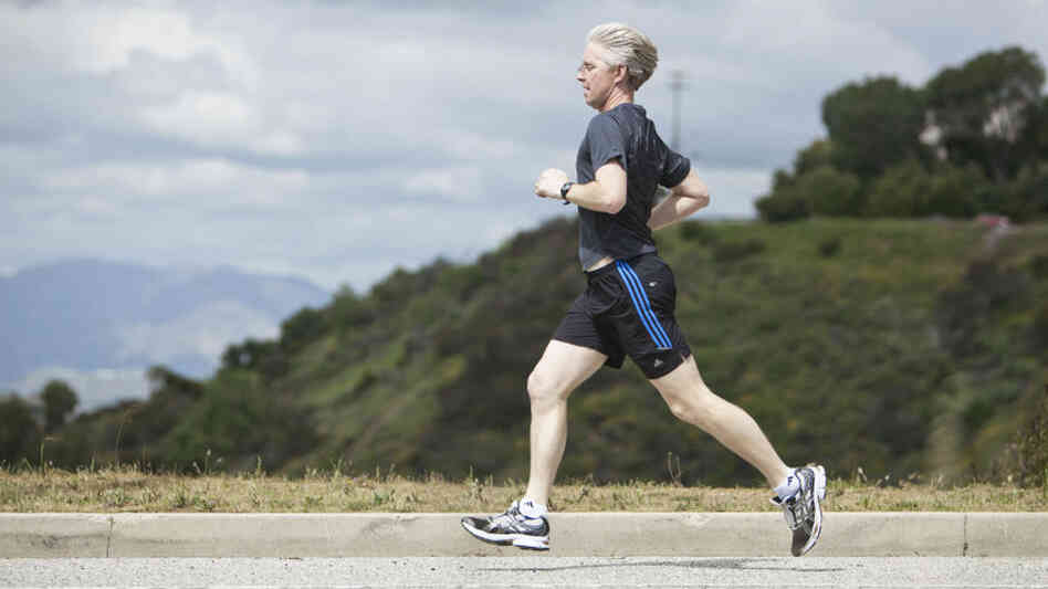 Paul Rider runs on Mulholland Drive in Los Angeles, March 25, 2011. Researchers say a moderate running regimen is actually beneficial for the joints of people with healthy knees.