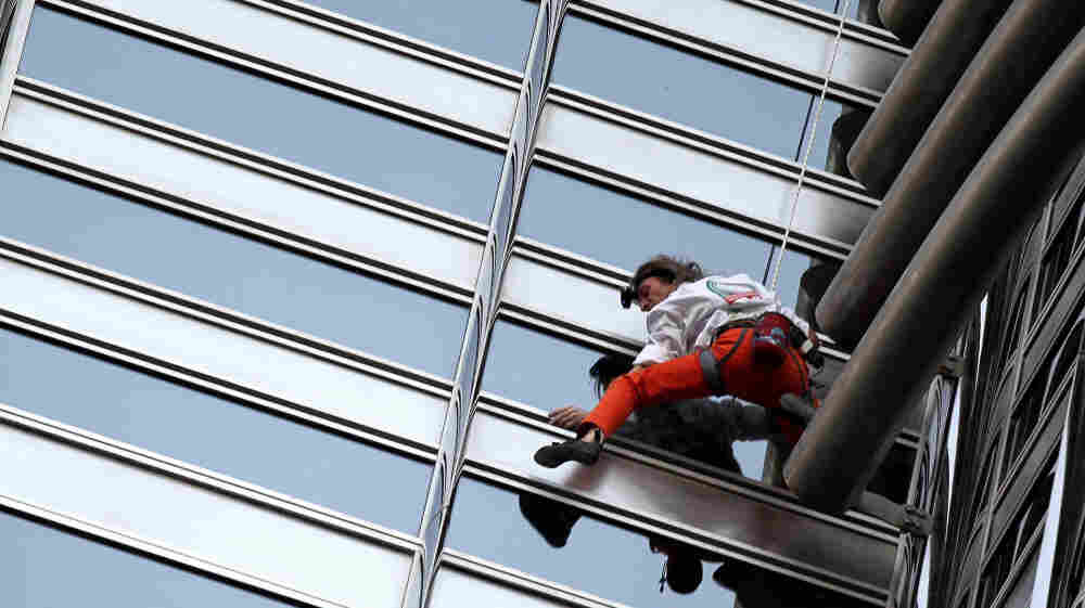 French climber Alain Robert scales the World's tallest tower in Dubai.