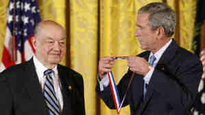 In a Sept. 29, 2008 file photo then President Bush presents Paul Baran a 2007 National Medal of Technology and Innovation in the East Room of the White House in Washington.