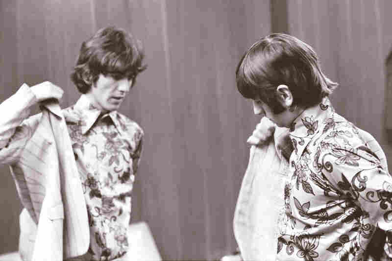 Harrison and Ringo Starr dress before going on stage in Detroit, on Aug. 13, 1966.