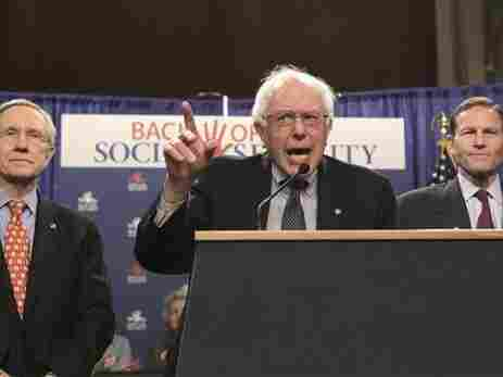 """Sen. Bernie Sanders, (I-VT) center, flanked by Senate Majority Leader Harry Reid of Nev., (l) and Sen. Richard Blumenthal, (D-CT) at a """"Back Off Social Security"""" rally, March 28, 2011."""