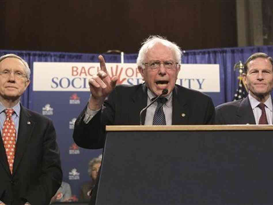 "Sen. Bernie Sanders, (I-VT) center, flanked by Senate Majority Leader Harry Reid of Nev., (l) and Sen. Richard Blumenthal, (D-CT) at a ""Back Off Social Security"" rally, March 28, 2011."