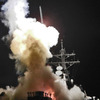 The USS Barry launches a Tomahawk missile, targeting radar and anti-aircraft sites along Libya's Mediterranean coast on Saturday.