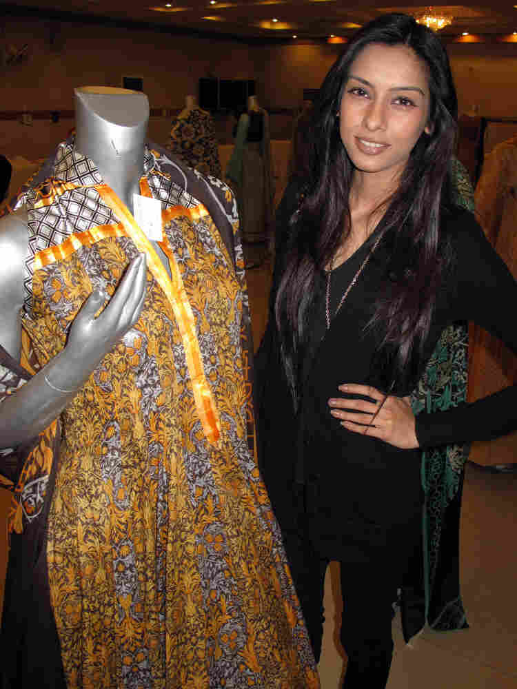 """Lahore model Noor Bhatti stands before designer Veneeza Ahmed's lawn collection. Bhatti says the """"light, airy"""" lawn represents """"renewal"""" and the impending start of spring."""