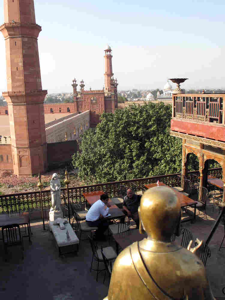 """Painter Iqbal Hussain's terrace overlooks the fabled Badshahi Mosque, dating to the Mughal emperors. """"This is the best part of Lahore: We have all four seasons in Lahore, and the spring is the best one,"""" he says."""