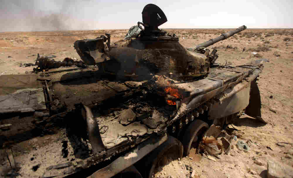 A Libyan loyalist army tank burns in the town of Ajdabiya on March 26, 2011.