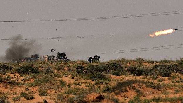 Rebels fired missiles at forces loyal to Libyan leader Moammar Gadhafi near the town of Bin Jawad.