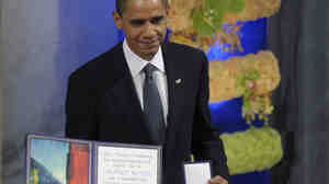 """President Obama displays his Nobel Peace Prize during a ceremony in Oslo in December 2009. During his acceptance speech, the president discussed the concept of a """"just war,"""" saying: """"There will be times when nations — acting individually or in concert — will find the use of force not only necessary but morally justified."""""""