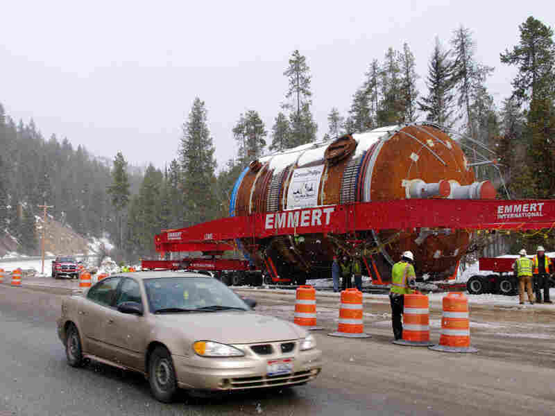 A coke drum waits along Montana's U.S. Highway 12 during a dry-run shipment in early March. The load can travel only late at night and is destined for a new oil refinery in Billings, Mont.
