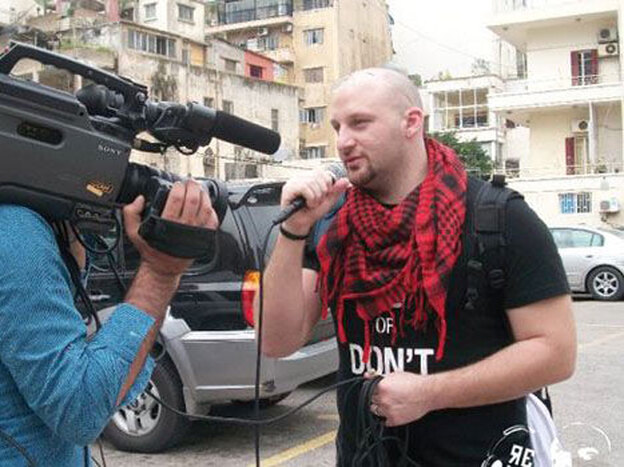 Hass Dennoui, founder of Re-Volt Radio, a platform promoting Arab hip-hop, films a spot along a street in Jeddah, Saudi Arabia.