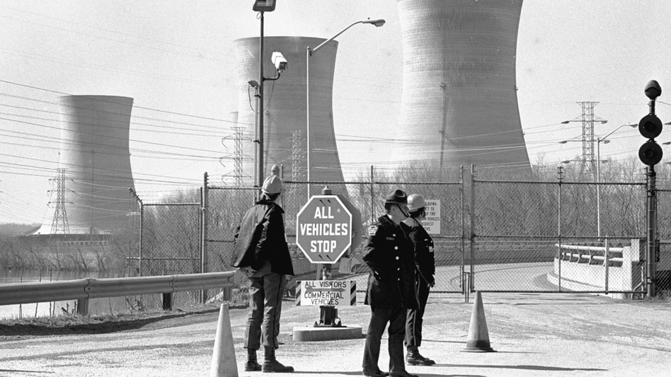 A Pennsylvania state trooper and plant security guards stand outside the closed front gate to the Metropolitan Edison nuclear power plant on Three Mile Island near Harrisburg, Pa., in 1979. (Paul Vathis, File Photo/AP)
