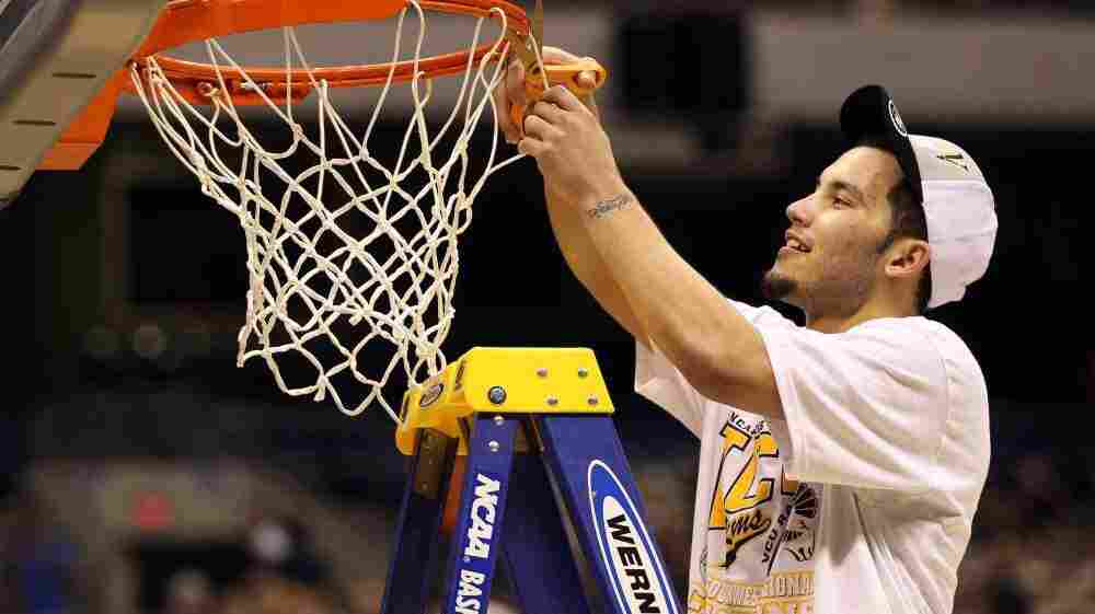 Joey Rodriguez of the Virginia Commonwealth Rams cuts the net after defeating the Kansas Jayhawks yesterday in the highly unpredictable 2011 NCAA men's basketball tournament.