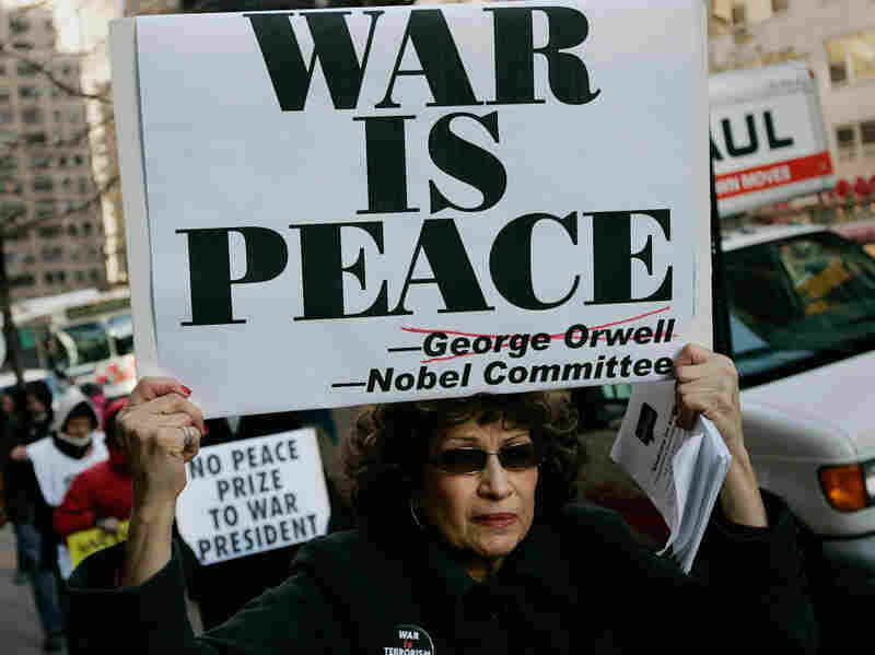 Members of the group The World Can't Wait demonstrate in New York against President Obama's Nobel Peace Prize after his December 2009 announcement of a troop surge in Afghanistan. Since the strike on Libya began, some peace activists have called on the president to return his Nobel.