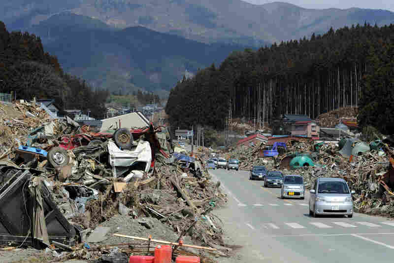 Rikuzentakata, once home to 23,000 people, is a landscape of splintered two-by-fours, upside-down boats, and cars and trucks half buried in the wreckage.