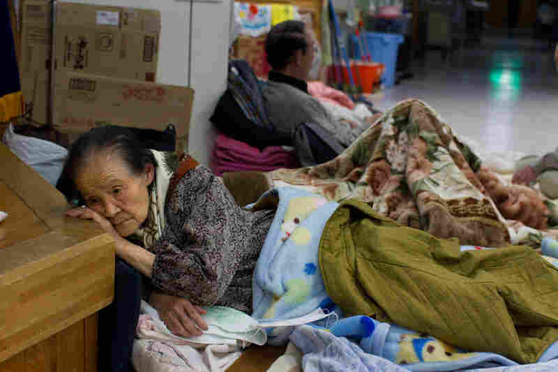 Earthquake victims rest at a crowded makeshift evacuation center Saturday. Hundreds of thousands have become homeless in Rikuzentakata.