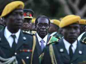 Zimbabwean President Robert Mugabe stands at his 2008 inauguration ceremony at the statehouse in Harare.