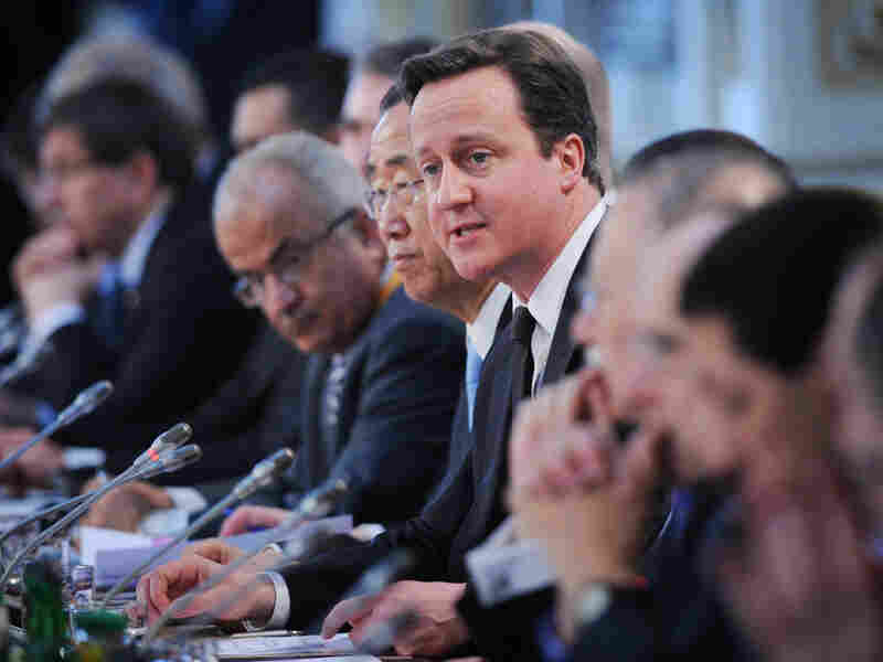 British Prime Minister David Cameron speaks Tuesday at the  opening of the Libyan Conference, a meeting of international allies to discuss  the next steps for the country, in London.