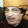 Libyan leader Moammar Gadhafi arrives at  the Rixos hotel in the capital Tripoli on March 8.