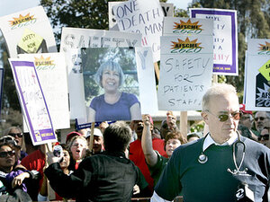 At a rally at Napa State Hospital in January, workers demand better safety measures for staff and patients. One worker carries a sign with a photo of Donna Gross, a hospital worker killed last year, allegedly by a patient.