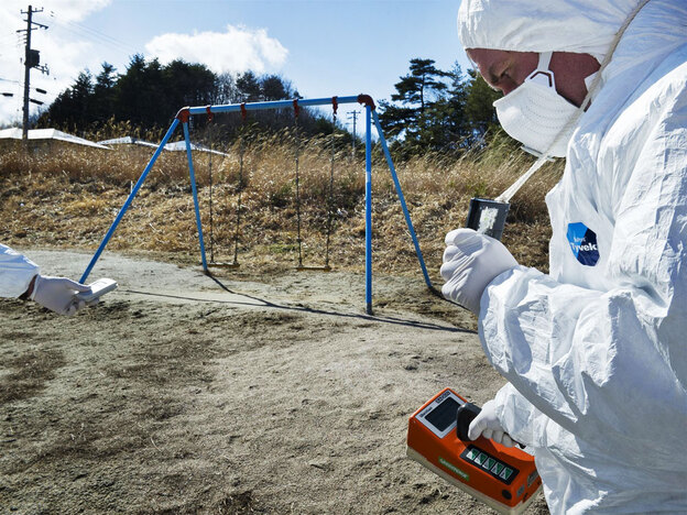 On March 27, members of the environmental group Greenpeace monitor contamination levels at Iitate village near the Fukushima nuclear complex, just outside the 12-mile mandatory evacuation zone. The area is not under any order to evacuate, yet nearly half of Iitate's 6,000 residents have fled town.
