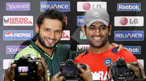 "Pakistani captain Shahid Afridi (left) and India's captain, Mahendra Singh Dhoni, at a news conference in Mohali, India, on Tuesday. The two men and their teams will face off Wednesday in a World Cup semifinal that is being dubbed ""the mother of all matches."""