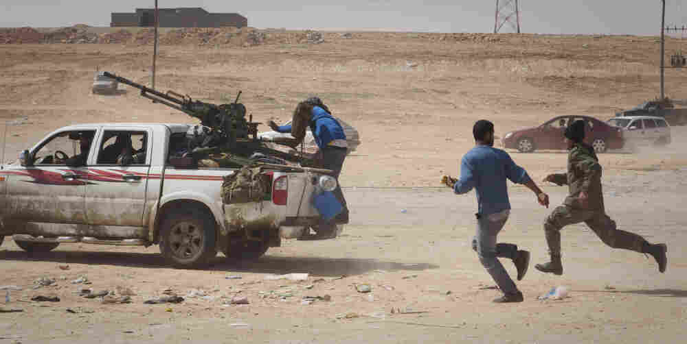 Libyan rebels flee from Gadhafi forces outside of Bin Jawaad on Tuesday, March 29, 2011.