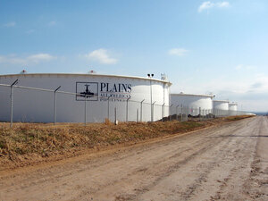 Huge tanks help house the oil surplus in Cushing, Okla. Each tank holds more than 250,000 barrels of oil.