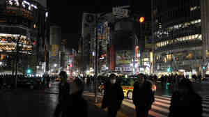 With its massive electronic billboards now dark, Tokyo's Shibuya fashion district is far more subdued than it was before the March 11 earthquake and tsunami.