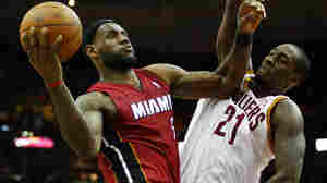 LeBron James of the Miami Heat drives to the basket against J. J. Hickson of the Cleveland Cavaliers on Tuesday night, where Cleveland avenged an old injury.