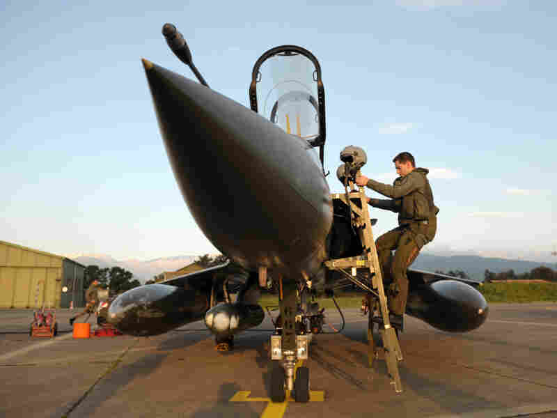 A French pilot gets into the cockpit of a Mirage 2000 jet at the Solenzara base.