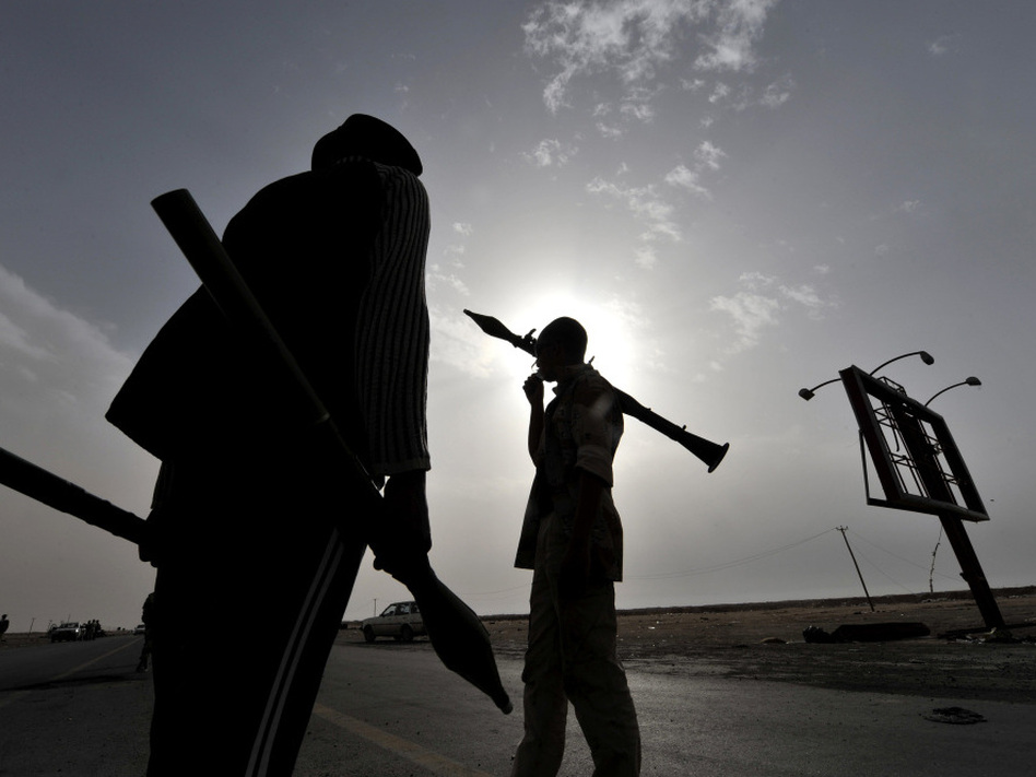 Libyan rebels carry rocket-propelled grenades as they take position at the west gate of the eastern city of Ajdabiya on Wednesday. (AFP/Getty Images)
