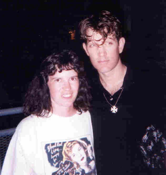 """As a MAJOR Chris Isaak fan, I go to as many concerts as I can, as far back as the 1993 Canadian Exhibition in Toronto. I had been a fan for years but had never seen him live. After the show, he came out and met everyone, signed programs, and had a photo taken with me. It's been on my piano ever since. Since then, I have traveled all over North America to see him. I have so many signed T-shirts..."
