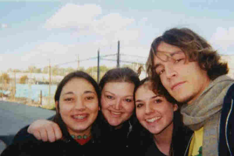 """This is me and my two best friends with Brandon Boyd of Incubus back in about 1999 or 2000. We were in high school and had driven five hours to their show in St. Louis. We were in line for hours so we could get a good spot. Then, the whole band came out to talk to the fans! We were speechless and nearly in tears. You can't see, but I was grabbing Brandon Boyd's arm SO HARD. I'm sure he thought..."