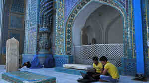 Afghan youth work on a laptop at the Rawz-e Sharif shrine in northern Mazar-e Sharif city in Balkh province on July 16.
