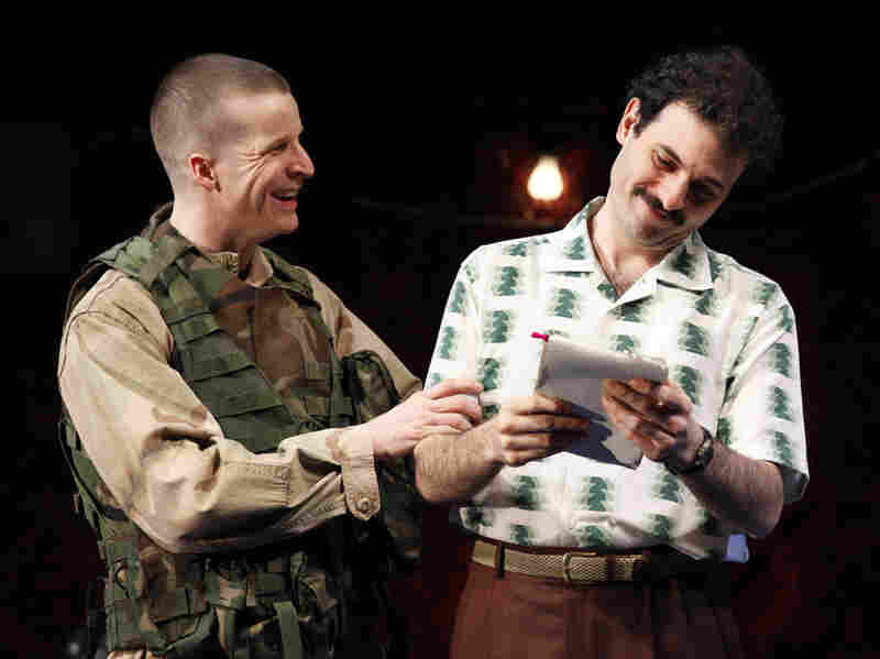 Brad Fleischer (left) plays an American soldier, aided by an Iraqi translator (Arian Moayed), formerly the gardener for Uday Hussein, Saddam Hussein's elder son.