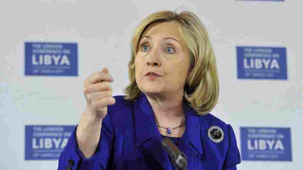 Secretary of State Hillary  Clinton speaks during a news conference after a meeting on Libya in  London  Tuesday. World powers agreed that Moammar  Gadhafi should step down after 42 years as Libya's ruler but did not  discuss arming the rebels who seek to oust him.