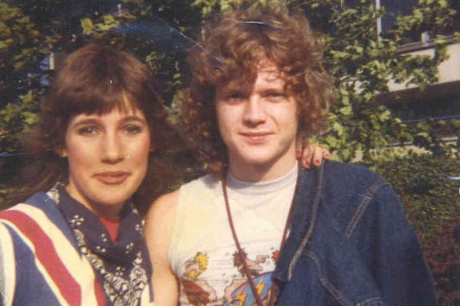 """Rick Allen of Def Leppard and me, on Aug. 4, 1984 in Portland, Ore., after my friend and I waited six hours to meet the band. I was completely psyched and acted like a giddy fool. He signed my super cool union jack shirt with a purple felt pen (days before sharpies!) and I've never washed it (and still have it) so it has serious ring around the collar and pits!! Haha."" (Courtesy of Rebecca Boy..."