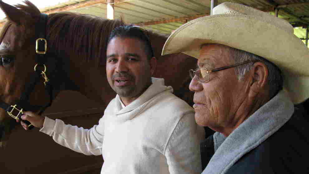Tomas Carlos and his father pose with their horse Great Bro.  They call their operation Hub City Farms, and they compete in horse shows all over the country.