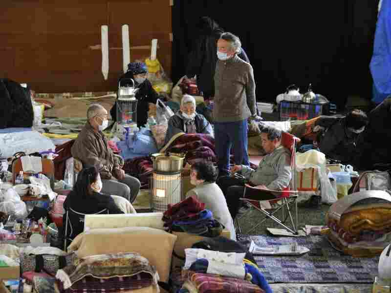 Evacuees rest in a shelter in Kamaishi, Japan, on March 25.