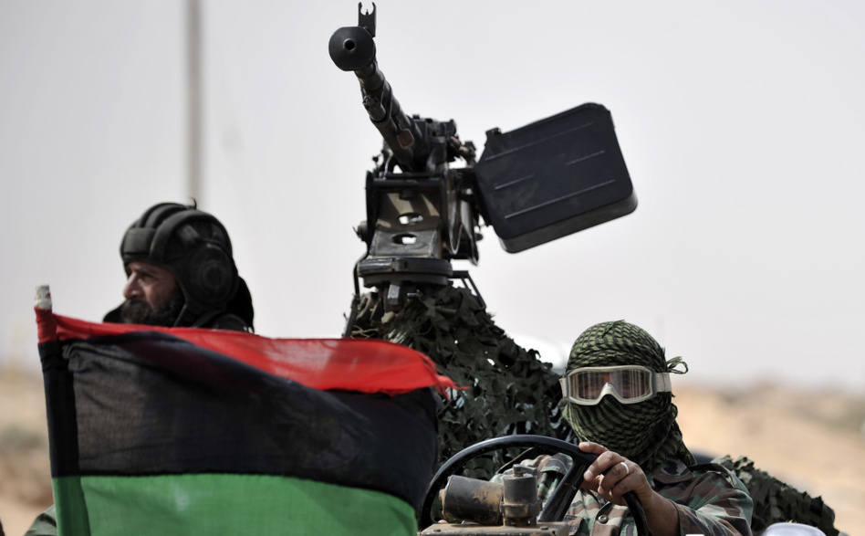 Libyan rebels returned from the battlefield outside the oil-rich town of Ras Lanuf on Tuesday.