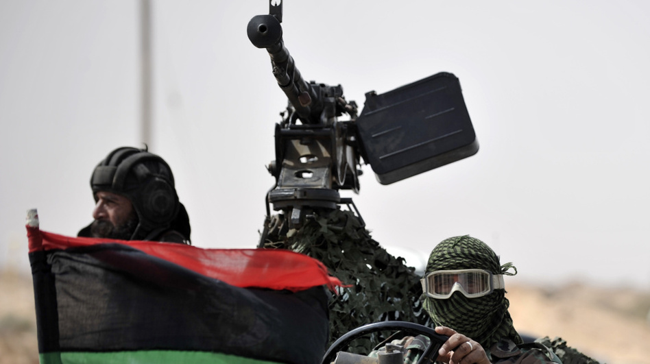 Libyan rebels returned from the battlefield outside the oil-rich town of Ras Lanuf on Tuesday. (AFP/Getty Images)