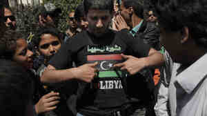 A protester wearing a T-shirt with the pre-Gadhafi Libyan flag takes part in a protest against Libyan leader Moammar Gadhafi in front of the Arab League headquarters in Cairo on March 22.