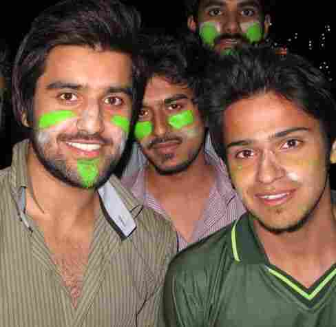 Arsalan Ghazi, front left, and Danish Ilyas, front right, showing their colors and hoping that despite Pakistan's loss the match will be a step toward better relations with India.