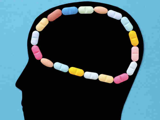 An illustration showing pills in the profile of human head.