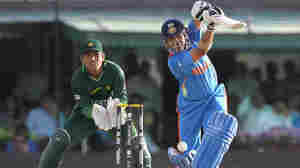 Sachin Tendulkar of India, right, bats as Kamran Akmal of Pakistan looks on earlier today (March 30, 2011).