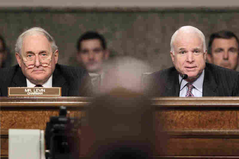 Senate Armed Services Committee Chairman Sen. Carl Levin (D-MI, left) and ranking member Sen. John McCain (R-AZ) listen to testimony Tuesday by Air Force Gen. C. Robert Kehler on the U.S. mission in Libya.