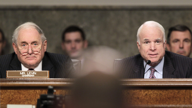 Senate Armed Services Committee Chairman Sen. Carl Levin (D-MI, left) and ranking member Sen. John McCain (R-AZ) listen to testimony Tuesday by Air Force Gen. C. Robert Kehler on the U.S. mission in Libya. (AP)